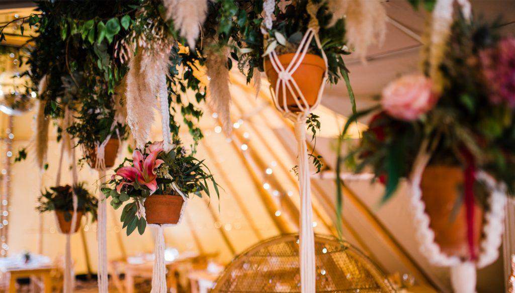 Flowers at tipi wedding reception