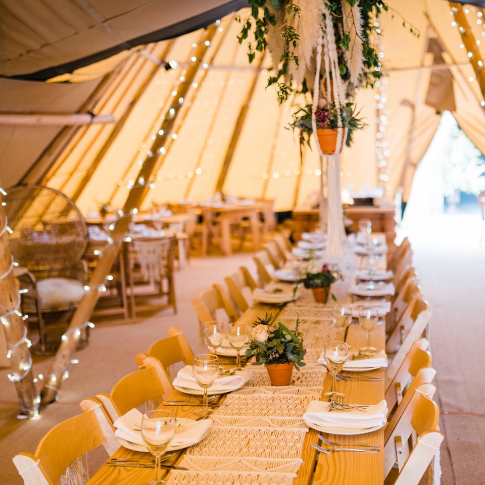 Wedding reception tables set for tipi wedding