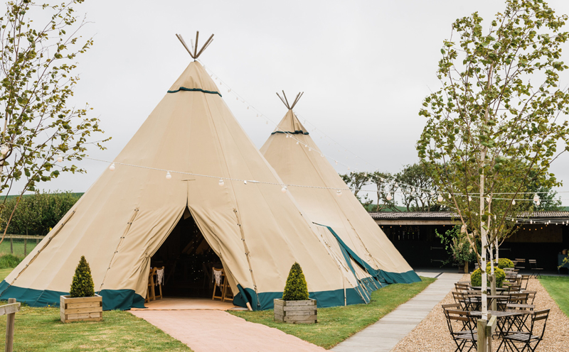 Tipi wedding venue exterior daytime